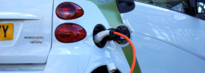 Electric vehicle being charged Faraday Battery Challenge Innovation Feasibility