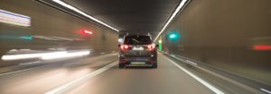 Fast moving car in tunnel at night Connected and Autonomous Vehicles grant funding