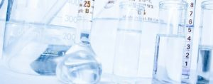 Flasks and bottles in laboratory - Health and Life Sciences Grant