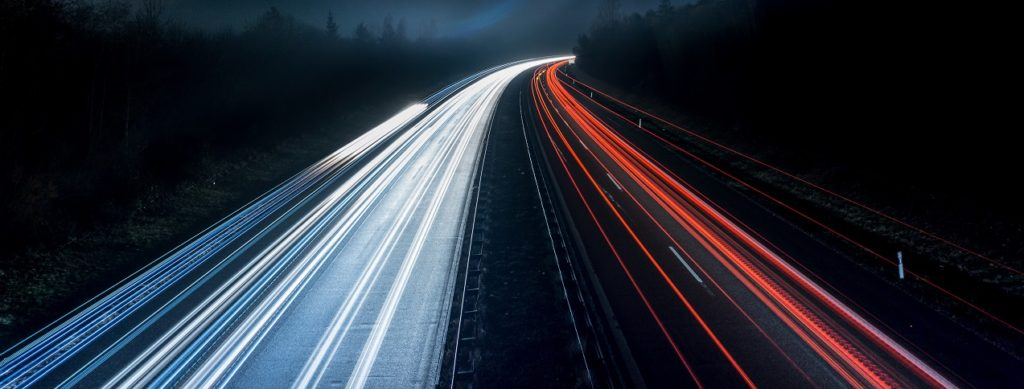 Motorway by night high speed cars Low Carbon Technology Grant Funding