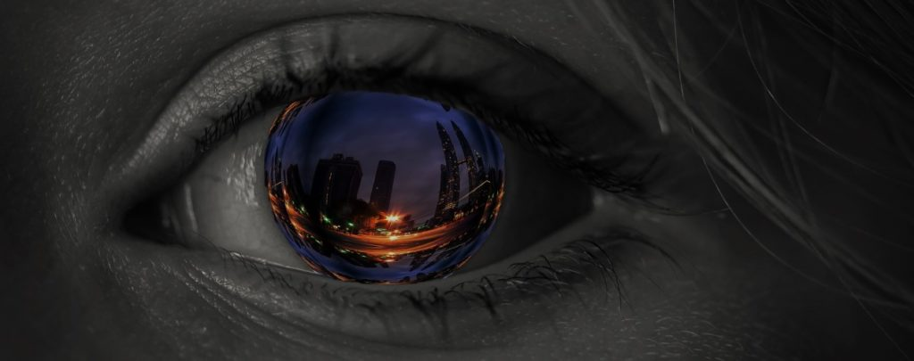 Close up eye with immersive content reflected in eyeball
